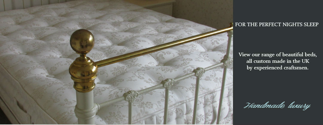 an antique victorian bed with a made to measure bed base and mattress