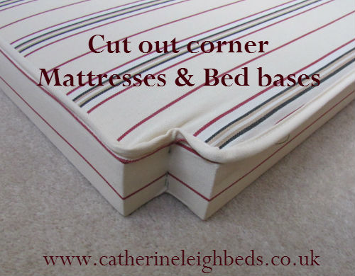 A mattress base with cut out corners to fit a french bed